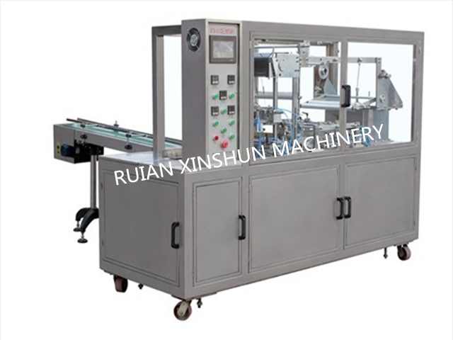 XS2100A Type Pneumatic Adjustable Cellophane Film Tridmensional Packer(Bringing Antiforging Pull Line)